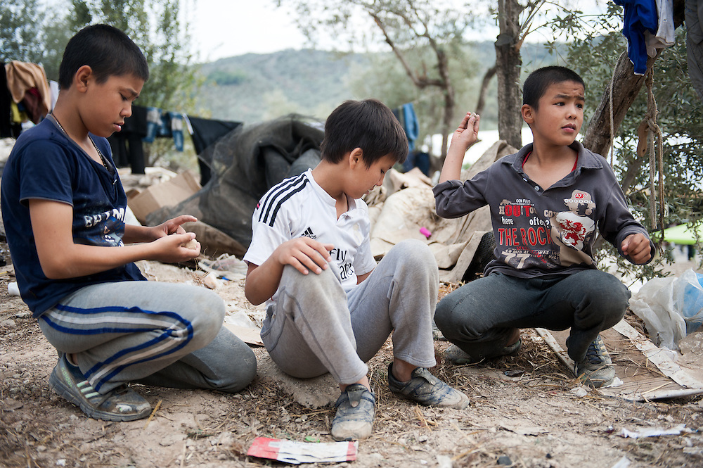 Elias Mohamedi 10 years old , Abulfaz 9 years old and Mehendi 7 years old - brothers and cousin (white t-shirt), Afghans that use to live in Iran play at Moria camp, Lesvos, Greece.