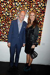 DYLAN JONES and his wife SARAH at an exhibition entitled 'Cut Flowers' by Robin Derrick held at 70a Silverthorne Road, London SW8 on 8th October 2008.