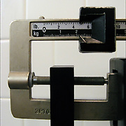Scale showing both weight in pounds and kilograms. .Kilogram (kg)  unit of measurement basic unit of mass in the metric system