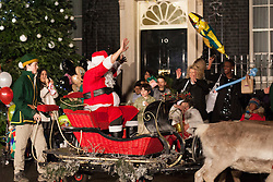 © licensed to London News Pictures. London, UK 17/12/2012. A 'Santa' waving to children and leaving Downing Street after the Christmas Party at Number 10, Downing Street. Photo credit: Tolga Akmen/LNP