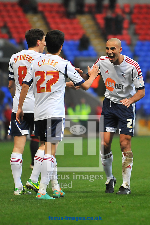 Picture by Ste Jones/Focus Images Ltd +44 7706 592282.05/01/2013.Darren Pratley of Bolton Wanderers congratulates Lee Chung-Yong of Bolton Wanderers on his opening goal during the The FA Cup match at the Reebok Stadium, Bolton.