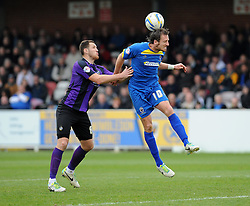 AFC Wimbledon's Jack Midson wins the header against Bristol Rovers' Tom Parkes - Photo mandatory by-line: Dougie Allward/JMP - Mobile: 07966 386802 05/04/2014 - SPORT - FOOTBALL - Kingston upon Thames - Kingsmeadow - AFC Wimbledon v Bristol Rovers - Sky Bet League Two