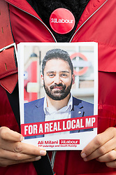 © Licensed to London News Pictures. 03/11/2019. London, UK. A woman hold a Ali Milani general election campaign leaflet. Mr Milani is the Labour Party General Election candidate for in Uxbridge & South Ruislip. He hopes to defeat British Prime Minister Boris Johnson who is MP for the constituency. Photo credit: Ray Tang/LNP