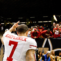 November 25, 2012; New Orleans, LA, USA; San Francisco 49ers quarterback Colin Kaepernick (7) runs off the field following a win over the New Orleans Saints at the Mercedes-Benz Superdome. The 49ers defeated the Saints 31-21. Mandatory Credit: Derick E. Hingle-US PRESSWIRE