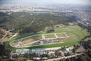 50,000-capacity horse-racing track & home of the Prix de l'Arc de Triomphe race, outside of Paris. Built on the banks of the Seine river, it is used for flat racing and is noted for its variety of interlaced tracks and a famous hill that provides a real challenge for competing thoroughbreds.