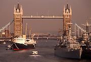 The Royal Yacht (HMY) Britannia visits the Thames at Tower Bridge to honour the Queen Mother's 90th birthday in Aug 1990. Moored midstream in the river, she sits alongside a Royal Navy warship and the WW2-era HMS Belfast. Her Majesty's Yacht Britannia was the former Royal Yacht of the British monarch, Queen Elizabeth II. She was the 83rd such vessel since the restoration of King Charles II in 1660. She is the second Royal yacht to bear the name, the first being the famous racing cutter built for The Prince of Wales in 1893. Following Labour's victory on 1 May 1997 it was announced that the vessel would be retired and no replacement would be built. She is now permanently moored as an exhibition ship at Ocean Terminal, Leith, Edinburgh, Scotland.