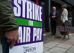 © Licensed to London News Pictures. <br /> 10/07/2014. <br /> <br /> Middlesbrough, United Kingdom<br /> <br /> Public sector workers stand on a picket line outside the Vancouver House government building in Middlesbrough town centre. <br /> <br /> The strike is part of a country wide action that will see an expected 1.5 million workers including teachers, firefighters and civil servant members of public sector unions such as Unison, Unite, GMB, PCS, FBU and NUT take part in the strike over pay, pensions and working conditions.<br /> <br /> Photo credit : Ian Forsyth/LNP