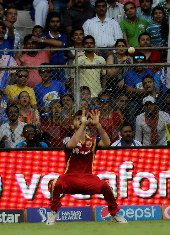 Mandeep Singh of Royal Challengers Bangalore takes a catch to get the wicket of Rohit Sharma captain of Mumbai Indians during match 46 of the Pepsi IPL 2015 (Indian Premier League) between The Mumbai Indians and The Royal Challengers Bangalore held at the Wankhede Stadium in Mumbai, India on the 10th May 2015.<br /> <br /> Photo by:  Pal Pillai / SPORTZPICS / IPL