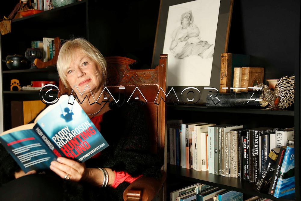 "Paddy Richardson with her novel ""Hunting Blind"" at home on the Otago Peninsula near Dunedin, New Zealand"