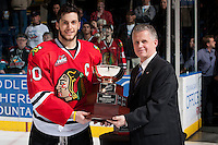 KELOWNA, CANADA - APRIL 25: Ron Robison, Commissioner of the Western Hockey League, prepares to hand the trophy to the Captain of the Portland Winterhawks on April 25, 2014 during Game 5 of the third round of WHL Playoffs at Prospera Place in Kelowna, British Columbia, Canada. The Portland Winterhawks won 7 - 3 and took the Western Conference Championship for the fourth year in a row earning them a place in the WHL final.  (Photo by Marissa Baecker/Getty Images)  *** Local Caption *** Ron Robison;