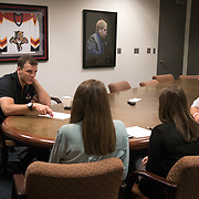 JUNE 15, 2017--SUNRISE, FLORIDA<br /> Shawn Thornton, a former Boston Bruins player known as the team's enforcer, is now the Florida Panthers VP for business operations. Here in an early morning meeting with staffers from the communications and digital media department, from left; Thomas Harding, Adelyn Biedenbach and Chrissy Parente.<br /> (Photo by Angel Valentin/Freelance)