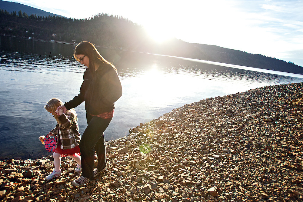 Kayleen Huffman and her daughter Alyvia, 5, walk along the shoreline of Lake Coeur d'Alene near Higgens Point enjoying an afternoon outing Wednesday in the unusually warm 55-degree January weather.