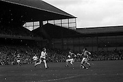 Kerry tries to run around on coming Tyrone player near the Tyrone goal during the All Ireland Minor Gaelic Football Final, Tyrone v Kerry in Croke Park on the 28th September 1975.