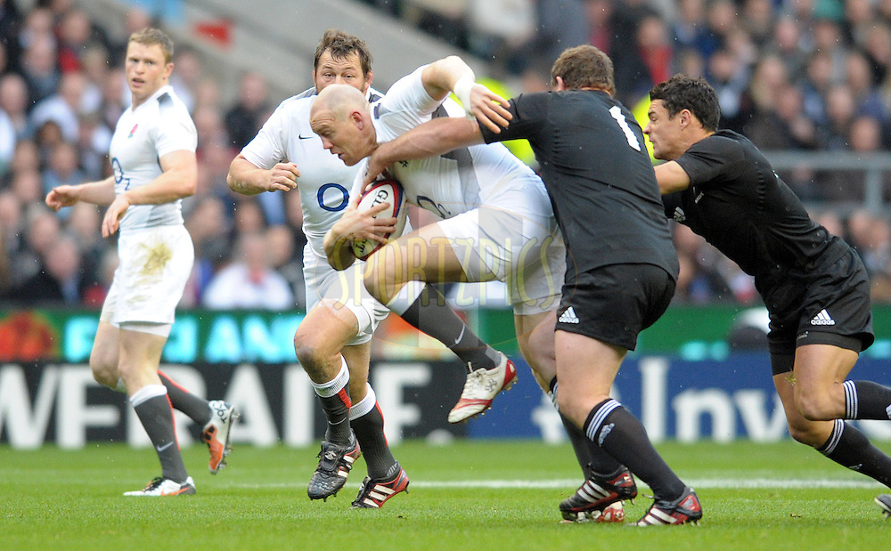 Photo © TOM DWYER / SECONDS LEFT IMAGES 2010 - Rugby Union - Investec Challenge - England v New Zealand - 06/11/10 - England's Mike Tindall on the charge tackled by Tony Woodcock early in the first half - at Twickenham Stadium UK -  All rights reserved