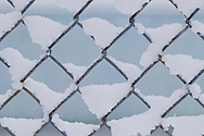 Middletown, New York - Snow caught in a fence on March 8, 2013.