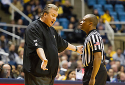 Feb 13, 2016; Morgantown, WV, USA; West Virginia Mountaineers head coach Bob Huggins argues a call with a referee during the first half against the TCU Horned Frogs at the WVU Coliseum. Mandatory Credit: Ben Queen-USA TODAY Sports