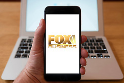 Using iPhone smartphone to display logo of Fox Business TV channel
