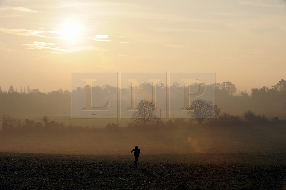© Licensed to London News Pictures. 112/12/2013<br /> Foggy weather Kent.<br /> A foggy and cold sunrise this morning  (12.12.2013) off Pilgrims Way, Otford in Kent.<br /> Photo credit :Grant Falvey/LNP