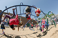 Holy Trinity pre K and Kindergarten students are up, down and all around during recess time in their playground off Messer Street on Thursday afternoon.  (Karen Bobotas/for the Laconia Daily Sun)