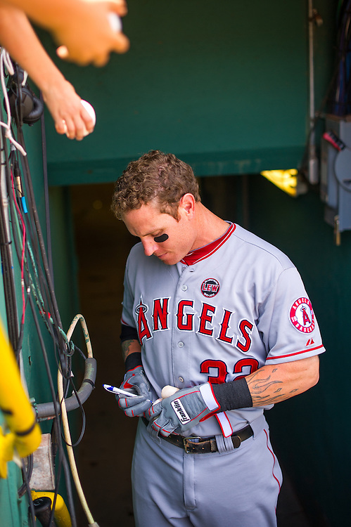 BOSTON, MA - JUNE 09: Josh Hamilton #32 of the Los Angeles Angels signs an autograph for a fan during the game against the Boston Red Sox at Fenway Park in Boston, Massachusetts on June 9, 2013. (Photo by Rob Tringali) *** Local Caption *** Josh Hamilton