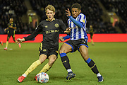 Kadeem Harris of Sheffield Wednesday and Mads Roerslev of Brentford FC compete for the ball during the EFL Sky Bet Championship match between Sheffield Wednesday and Brentford at Hillsborough, Sheffield, England on 7 December 2019.