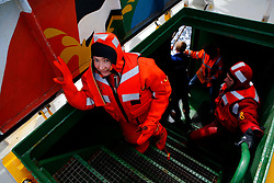 ATLANTIC OCEAN ABOARD ARCTIC SUNRISE 21MAY11 - Greenpeace activists return aboard the Arctic Sunrise from swim training in survival suits in the north Atlantic.....Photo by Jiri Rezac / Greenpeace