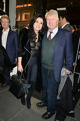 STANLEY JOHNSON and NANCY DELL'OLIO at a private view of works by Fernando Botero held at the Opera Gallery London, 134 New Bond Street, London on 10th February 2015.