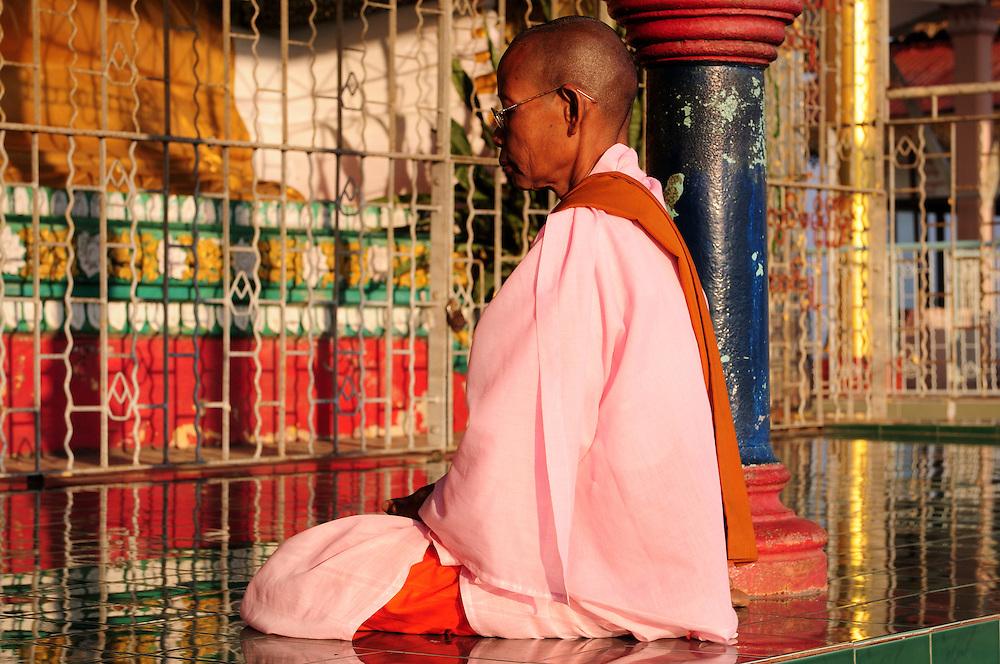 Female monk praying, Shwesandaw  pagoda,  Pyay, Myanmar
