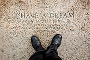"The words ""I have a Dream"" are carved into the granite step where Rev. Martin Luther King Jr. once held the famous speech at the Lincoln Memorial in Washington. Dedicated in 1922, the American national monument is a major tourist attraction and since the 1930s a symbolic center focused on race relations."