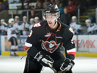 KELOWNA, CANADA, JANUARY 1: Jaynen Rissling #9 of the Calgary Hitmen skates on the ice as the Calgary Hitmen visit the Kelowna Rockets on January 1, 2012 at Prospera Place in Kelowna, British Columbia, Canada (Photo by Marissa Baecker/Getty Images) *** Local Caption ***