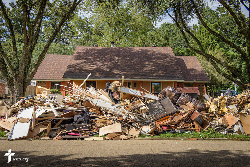 A home affected by August flooding is shrouded behind a curb full of debris in a neighborhood on Tuesday, Sept. 13, 2016, in Baton Rouge, La. LCMS Communications/Erik M. Lunsford