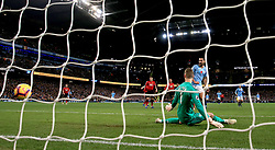 Manchester City's Ilkay Gundogan scores his side's third goal of the game during the Premier League match at the Etihad Stadium, Manchester.