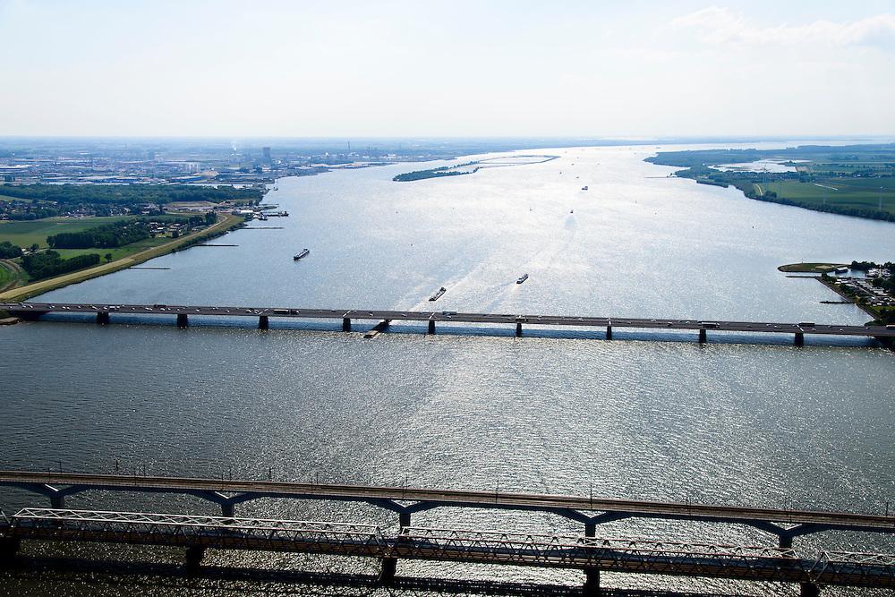 Nederland, Zuid-Holland, Hollandsch Diep 10-06-2015; Moerdijkbruggen over Hollandsch Diep. Brug voor autoverkeer (A16) in de achtergrond, spoorbruggen voorgrond. Gezien naar Moerdijk.<br /> Bridges across Hollands Diep, motorway and two railway bridges.<br /> luchtfoto (toeslag op standard tarieven);<br /> aerial photo (additional fee required);<br /> copyright foto/photo Siebe Swart