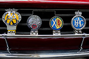 Detail of a British car club and motoring car badges including for the AA (Automobile Association), the patron saint of travel St Christopher, Scotland and the RAC (Royal Automobile Club), on the back of a vintage Rover car, on 29th June 2017, in Greenwich, London, England.