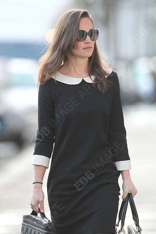 12.DECEMBER.2011. LONDON<br /> <br /> PIPPA MIDDLETON ARRIVES FOR WORK IN LONDON<br /> <br /> BYLINE: EDBIMAGEARCHIVE.COM<br /> <br /> *THIS IMAGE IS STRICTLY FOR UK NEWSPAPERS AND MAGAZINES ONLY*<br /> *FOR WORLD WIDE SALES AND WEB USE PLEASE CONTACT EDBIMAGEARCHIVE - 0208 954 5968*