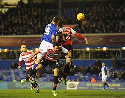 Birmingham City's Nikola Zigic heads towards goal forcing a save from Doncaster Rovers' Ross Turnbull - Photo mandatory by-line: Alex James/JMP - Tel: Mobile: 07966 386802 03/12/2013 - SPORT - Football - Birmingham - St Andrews - Birmingham City v Doncaster Rovers - Sky Bet Championship