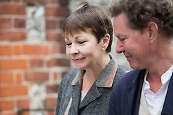 © Licensed to London News Pictures. 08/06/2017. Brighton, UK. MP and joint leader of the Green party Caroline Lucas arrives with her husband Richard and son Isaac at Florence Rd Baptist Church Hall in Brighton to vote in the General Election, today June 8th 2017. Photo credit: Hugo Michiels/LNP
