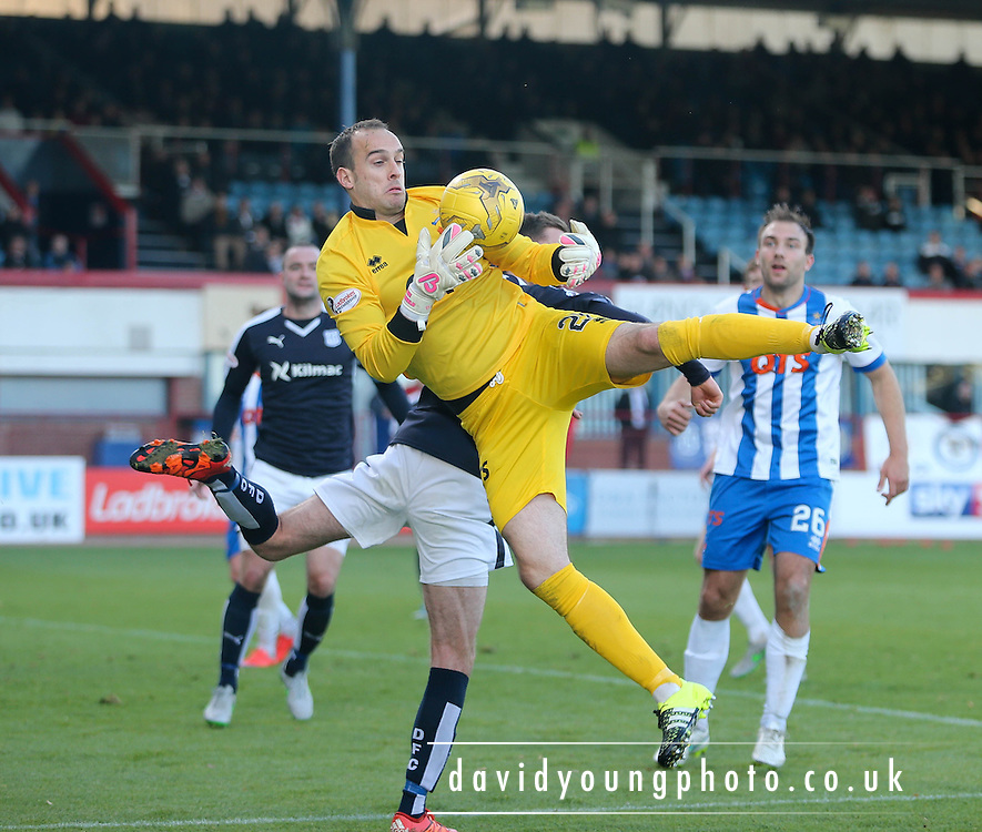\Kilmarnock&rsquo;s Jamie MacDonald clutches the ball under pressure from Dundee&rsquo;s Nick Ross  - Dundee v Kilmarnock, Ladbrokes Premiership at Dens Park <br /> <br />  - &copy; David Young - www.davidyoungphoto.co.uk - email: davidyoungphoto@gmail.com