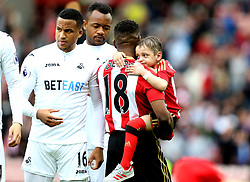 Jermain Defoe of Sunderland carries out young fan Bradley Lowery on to the pitch ahead of the fixture with Swansea City - Mandatory by-line: Robbie Stephenson/JMP - 13/05/2017 - FOOTBALL - Stadium of Light - Sunderland, England - Sunderland v Swansea City - Premier League