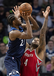 April 23, 2018 - Minneapolis, MN, USA - Minnesota Timberwolves' Andrew Wiggins (22) is defended by Rockets' P.J. Tucker (4) in the third quarter in Game 4 of their series Monday, April 23, 2018 at the Target Center in Minneapolis, Minn. The Rockets won, (Credit Image: © Carlos Gonzalez/TNS via ZUMA Wire)