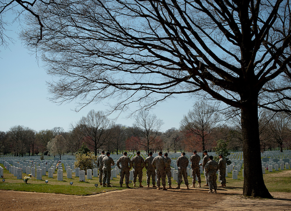 Soldiers from Special Forces Capt. Joseph W. Schultz's unit visit his gravesite March 14, 2012 at Arlington Cemetery in Arlington, VA. Schultz died May 29 while on a mounted patrol when the vehicle he and his Special Forces team were traveling in struck an IED in the Wardak Province, Afghanistan.
