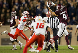 Texas A&M wide receiver Damion Ratley (4) catches a pass over the middle of the field as New Mexico defensive back Elijah Lilly (19) defends during the first quarter of an NCAA college football game on Saturday, Nov. 11, 2017, in College Station, Texas. (AP Photo/Sam Craft)