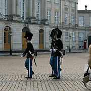 Change of the guard at Amalienborg, the winter home of the Danish Royal Family, located in Copenhagen's Frederiksstaden district. It consists of four identical palace façades with rococo interiors around an octagonal courtyard.  <br /> Photography by Jose More