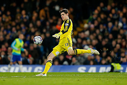 Thibaut Courtois of Chelsea clears during extra time - Photo mandatory by-line: Rogan Thomson/JMP - 07966 386802 - 27/01/2015 - SPORT - FOOTBALL - London, England - Stamford Bridge - Chelsea v Liverpool - Capital One Cup Semi-Final Second Leg.