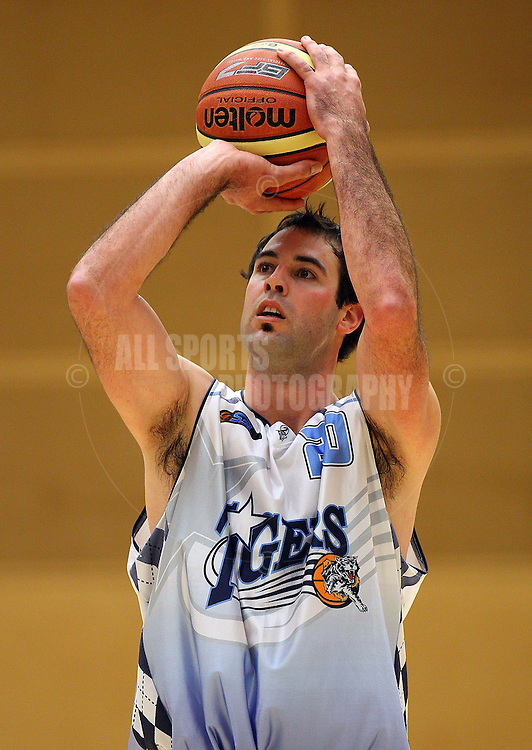 PERTH, AUSTRALIA - JULY 16: Mark Jones of the Tigers shoots a free throw during the week 18 SBL game between the Perry Lakes Hawks and the Willetton TIgers at The State Basketball Center on July 16, 2011 in Perth, Australia.  (Photo by Paul Kane/Allsports Photography)