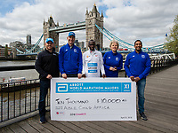 Eliud Kipchoge KEN winner of the Virgin Money London Marathon with representatives of Abbott at a photocall and press conference at the Guoman Tower Hotel for the winners of the Virgin Money London Marathon, 23 April 2018.<br /> <br /> Photo: Thomas Lovelock for Virgin Money London Marathon<br /> <br /> For further information: media@londonmarathonevents.co.uk