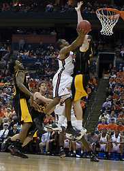 Virginia Cavaliers point guard Sean Singletary (44) gets a shot off against Albany.  The #4 seed Virginia Cavaliers defeated the #13 seed Albany Great Danes 84-57 in the first round of the South Region Men's NCAA Tournament in Columbus, OH on March 16, 2007.