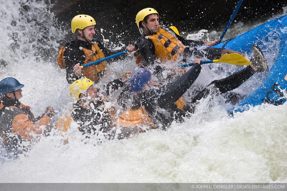 Unidentified whitewater rafters hang on to their raft as they go through the rapids at Sweets Falls on the Gauley River during American Whitewater's Gauley Fest weekend. The upper Gauley, located in the Gauley River National Recreation Area is considered one of premier whitewater rivers in the country.