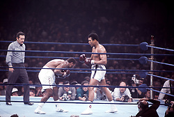 28 Jan 1972:  Joe Frazier, left, ducks away from Muhammad Ali during their second bout, Ali vs Frazier II, in New York, NY. .Mandatory Credit:  Icon Sports Media