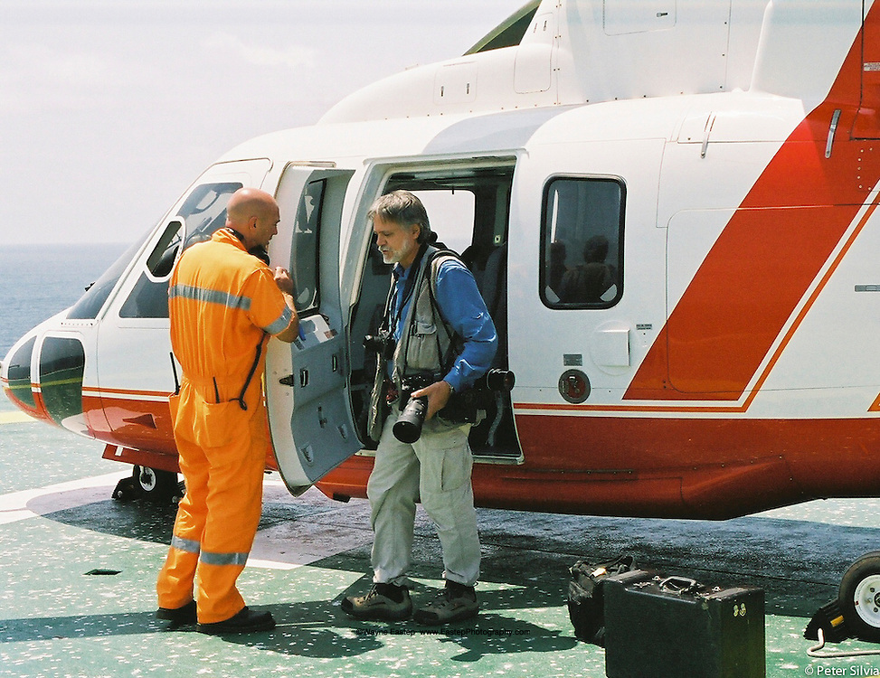 Wayne Eastep preparing for aerial photography of an FPSO offshore production site, Angola